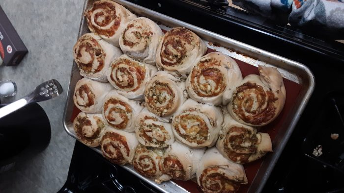 a sheet pan of freshly baked rolls