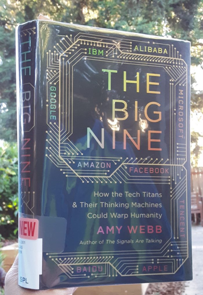 "cover of the book ""The Big Nine,"" taken outside"