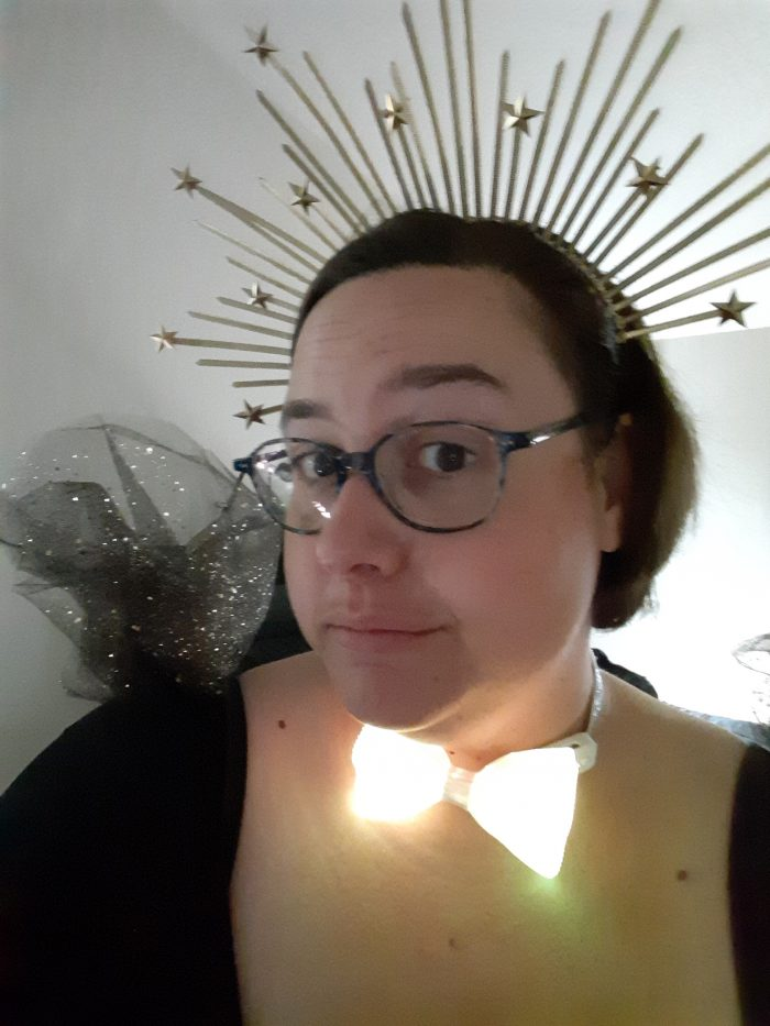 the author wearing a crown and fiber optic bow tie