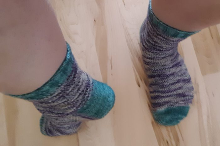 freshly knit socks on my feet, seen from above