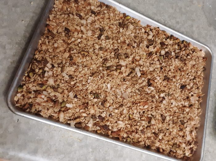 a sheet pan covered in granola