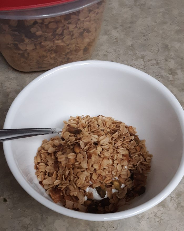 a bowl with yogurt and granola