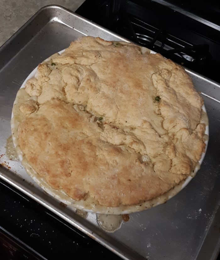a large chicken pot pie on top of the stove