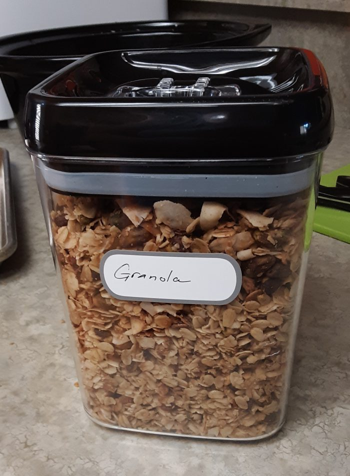 a plastic container filled with homemade granola