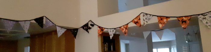 halloween bunting strung across my living room wall
