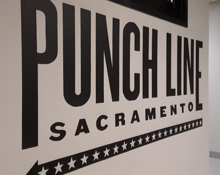 "photo of a painted sign that says ""Punch Line Sacramento"""