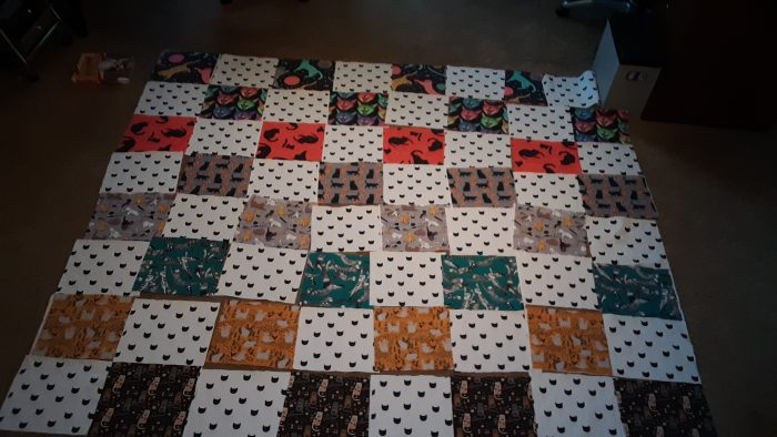 quilt squares arranged on the floor, pre sewing