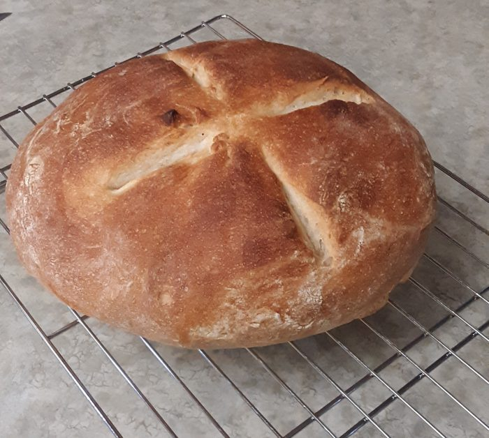 a round loaf of bread with an x scored on top