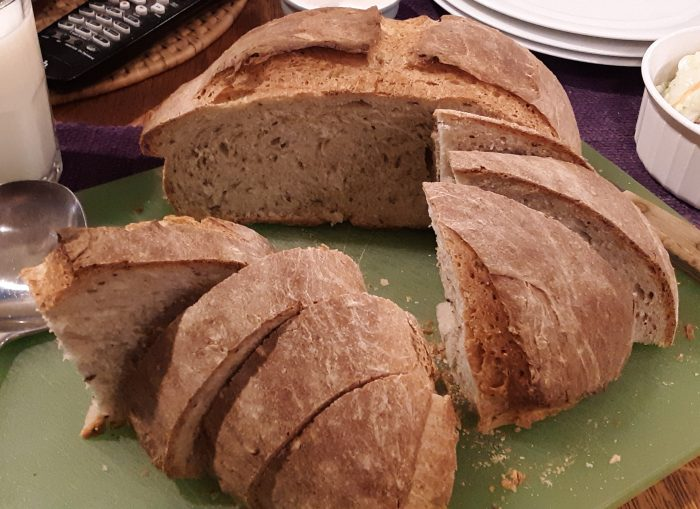 rye loaf cut in half, with half intact and half in wedges