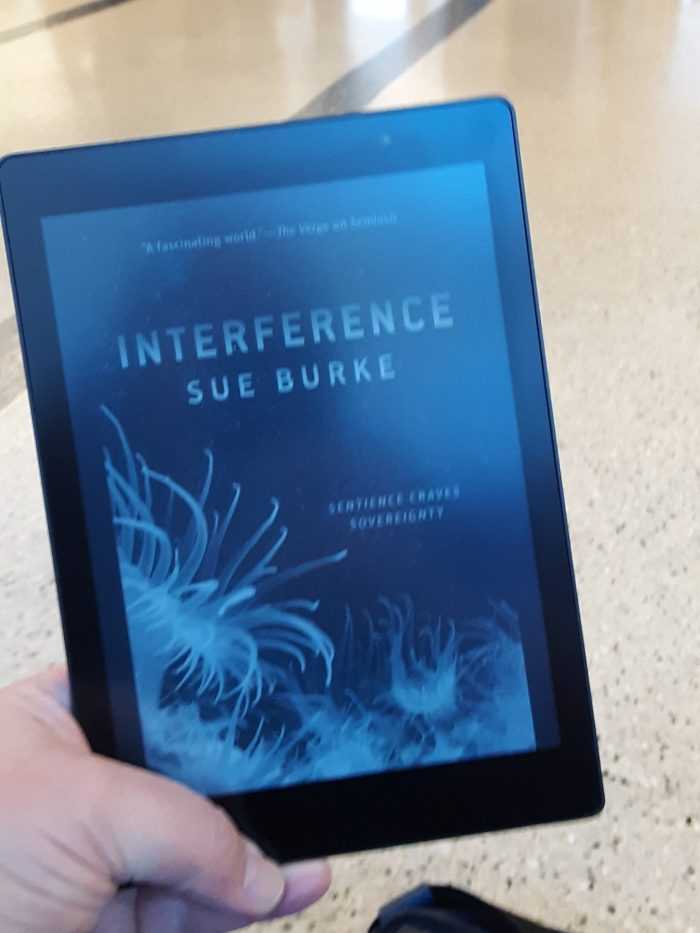 "cover of ""Interference"" by Sue Burke on Kobo, taken in an airport"