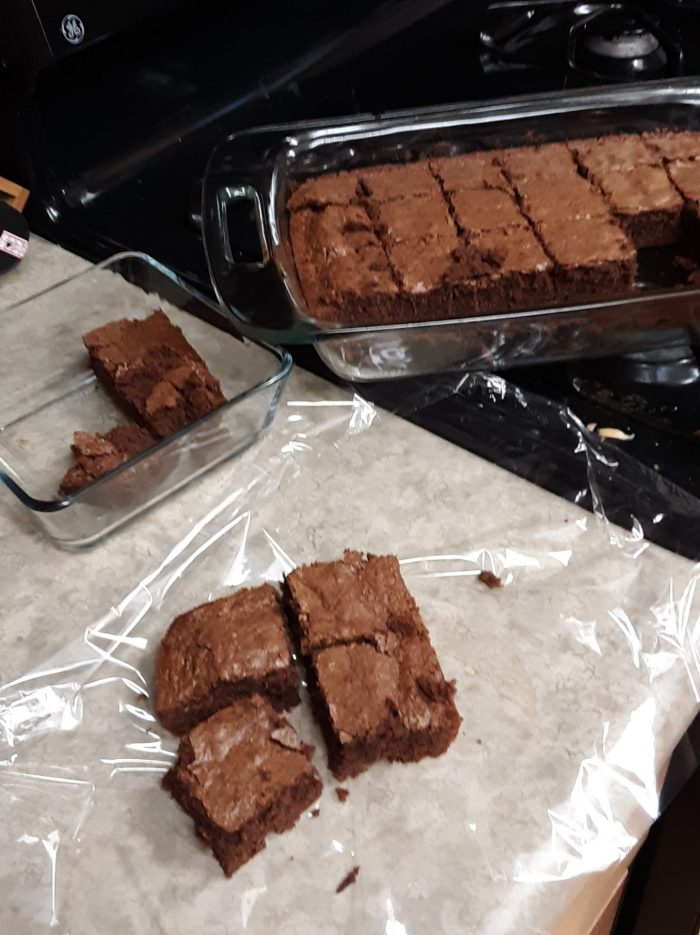 a pan of brownies, plus some brownies being wrapped in plastic