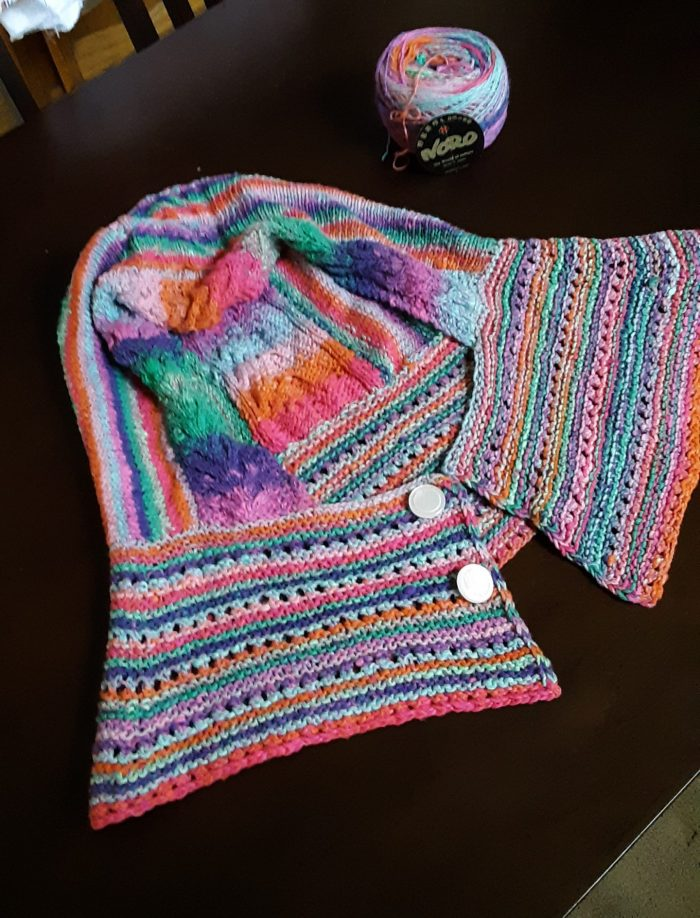 a hooded captlet knit in bright colors