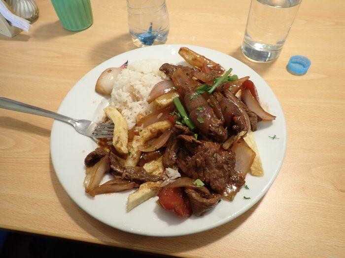 a plate of lomo saltado