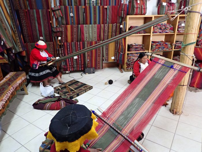 indigenous women weaving at the textile museum