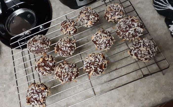 a wire cooling rack with chocolate coconut cookies