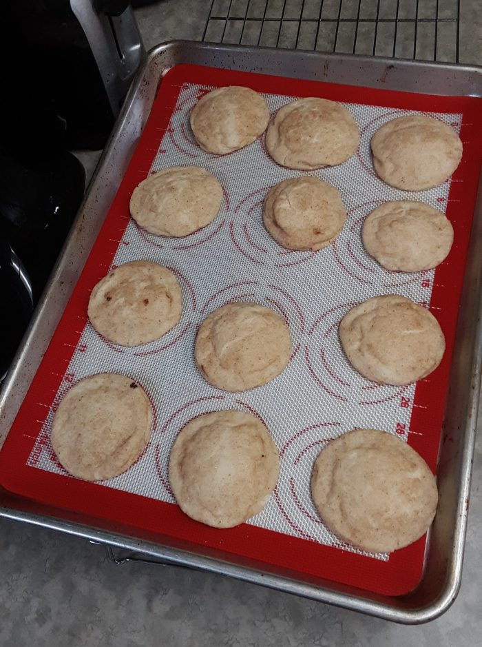 a pan of freshly baked snickerdoodle cookies