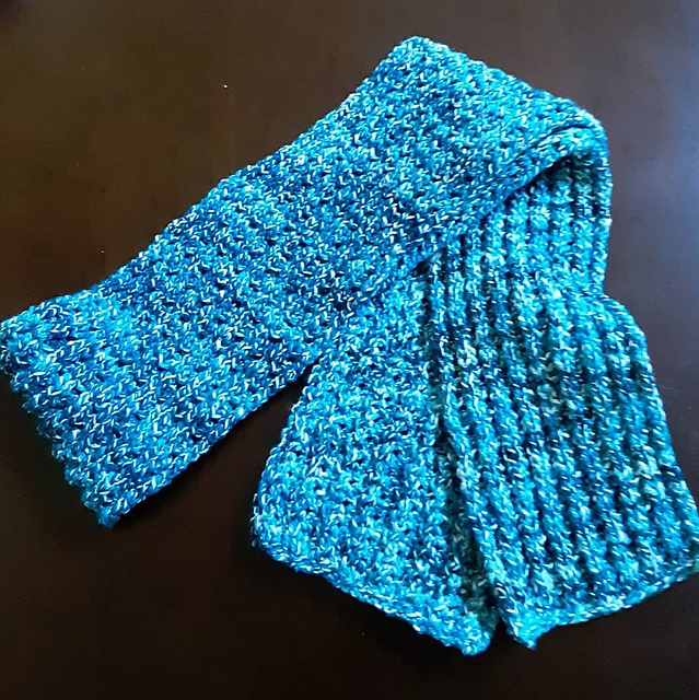 a scarf in a yarn of multiple shades of blue