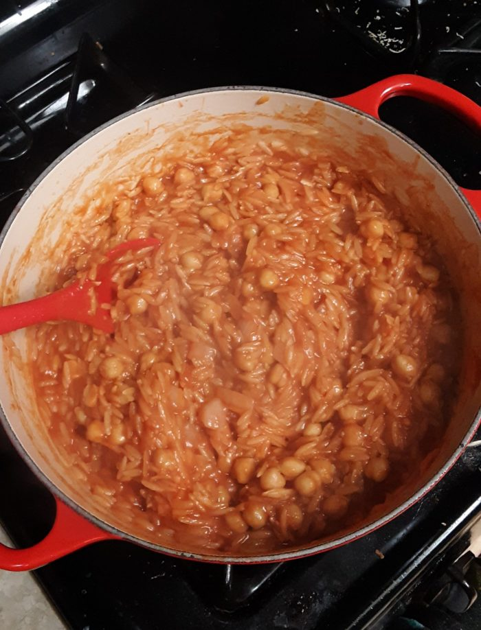 dutch oven filled with chickpeas and orzo
