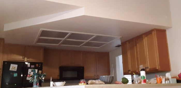 beofre remodeling: a box in the center of the kitchen that contains florescent fixtures