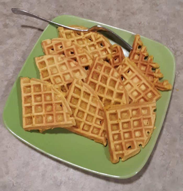 a plate of quartered carrot waffles