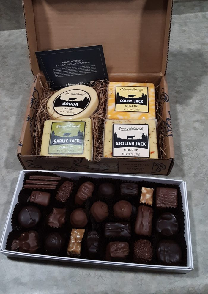 a box of chocolates and a gift box of cheeses