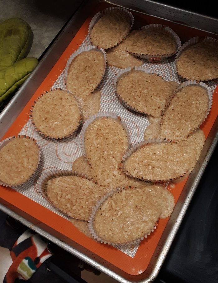 coconut muffins, most have overflowed their paper cups and merged together