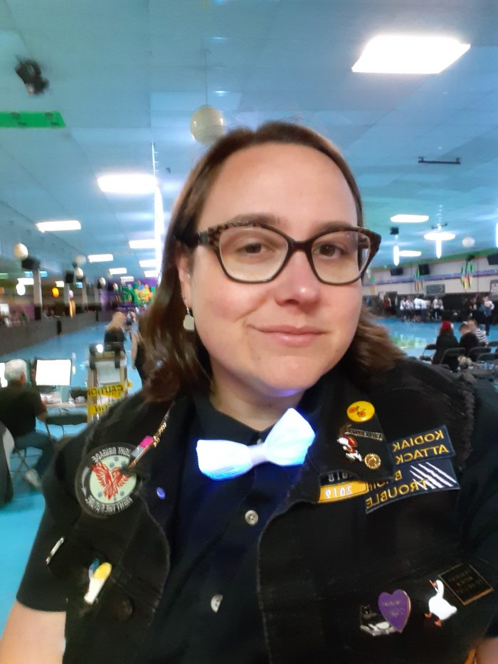 me, smiling at the camera, wearing my statement jacket thats covered in patches and pins