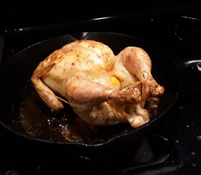 a roast chicken in a cast iron skillet