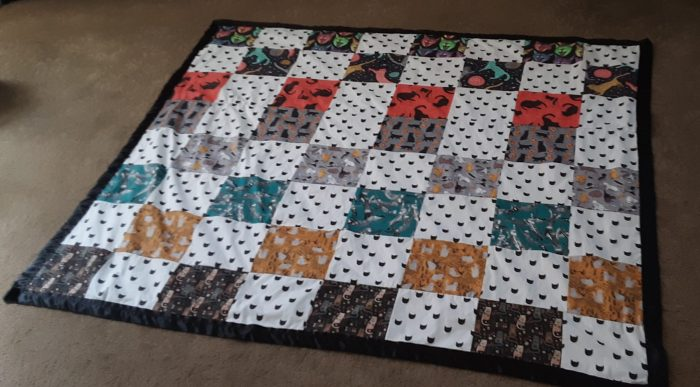 cat quilt laid out flat on the floor