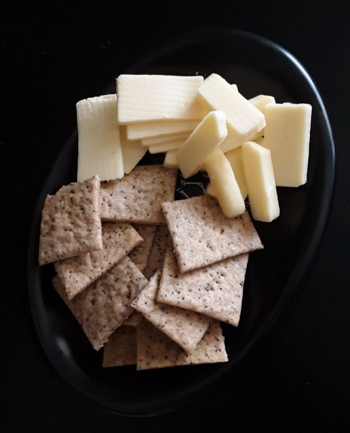a tiny plate of cheese and homemade crackers