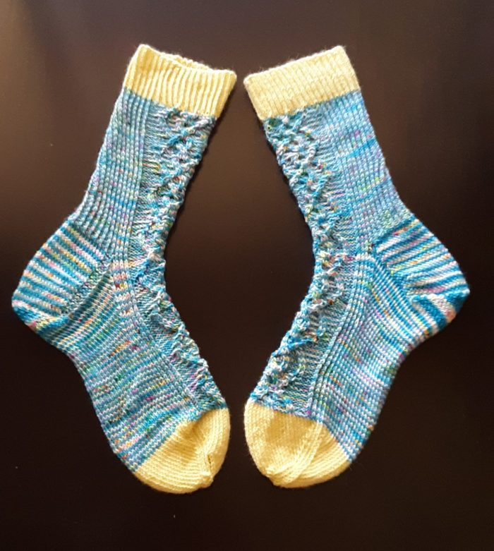 socks knit with the Helix pattern