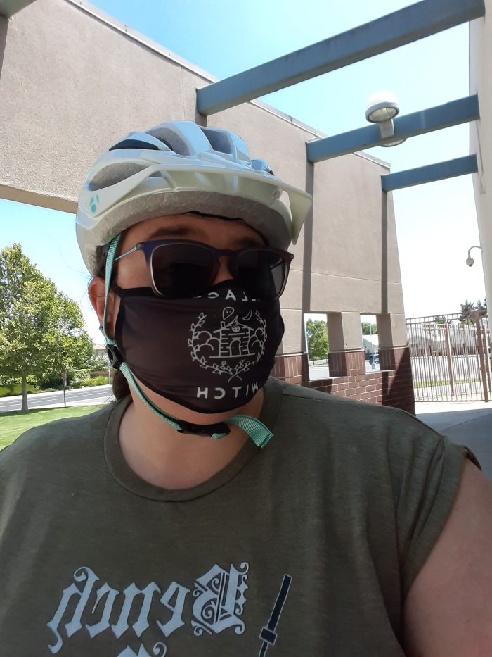 "me in a bike helmet and a face mask that says ""village witch"""
