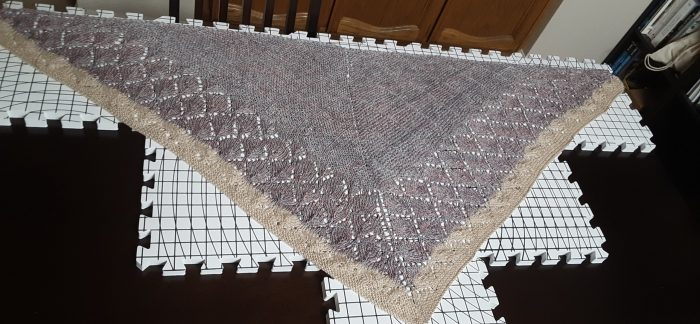 quaking aspen shawl laid out for blocking
