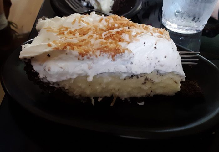 side view of a slice of coconut cream pie