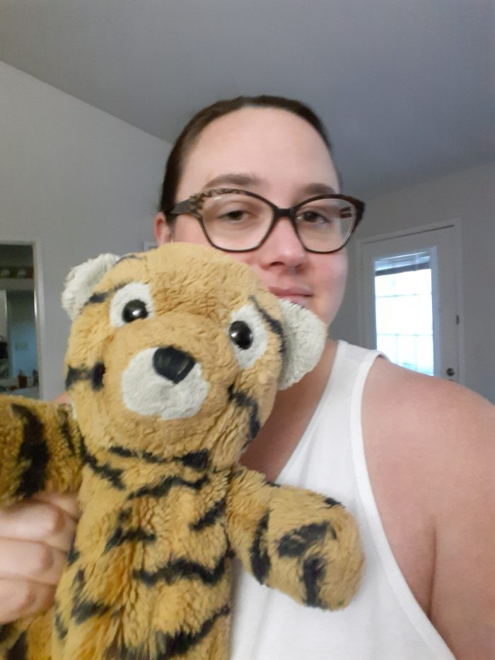Me holding a freshly washed Cuddles the stuffed tiger