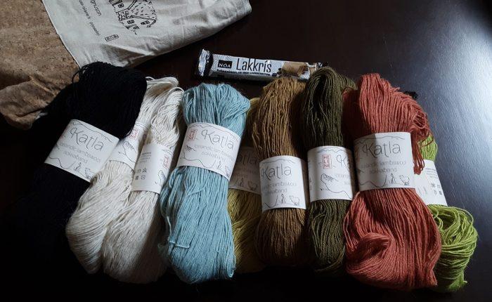 "A pile of yarn skeins in various colors. The tags say ""Katla, Icelandic lambswool"""