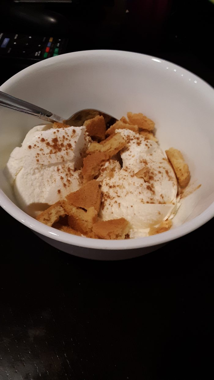 vanilla ice cream sprinkled with cinnmon and chunks of snickerdoodle cookies