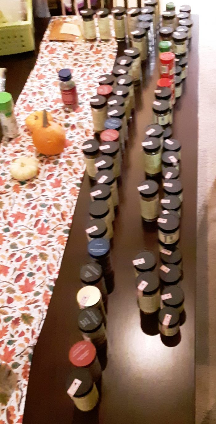 a ridiclous amount of spice jars lined up on our dining table