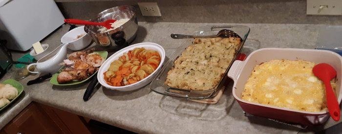 a wide shot of my counter covered in casseroles and other thanksgiving foods
