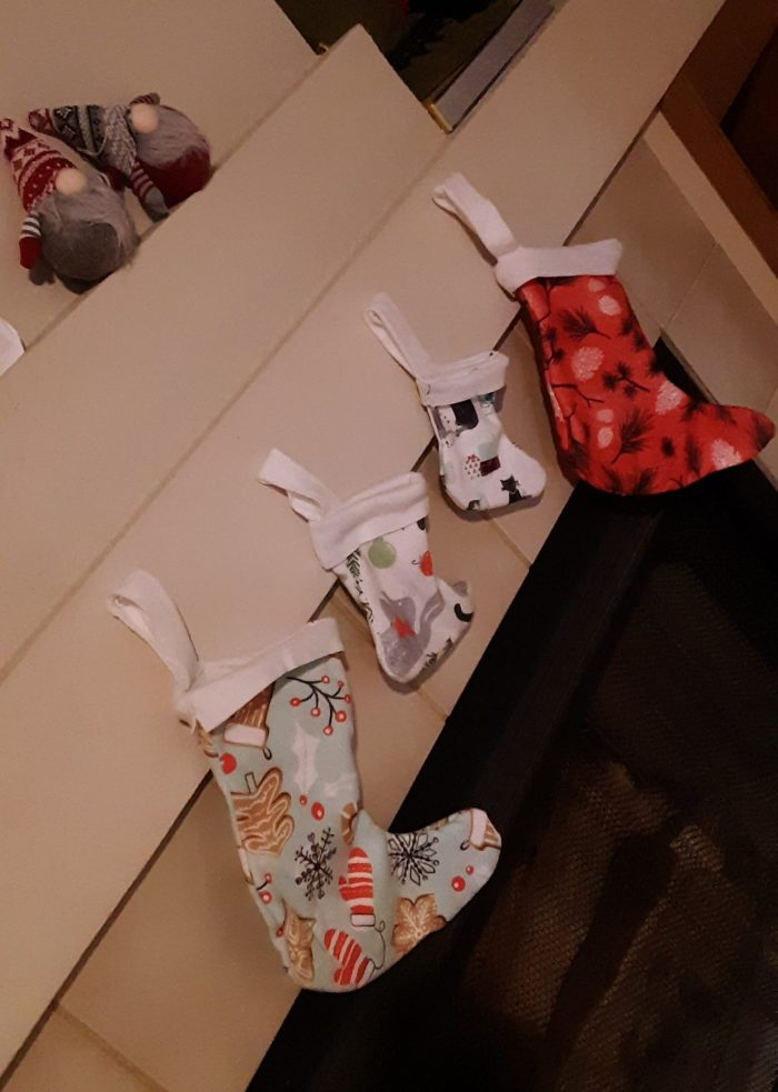 stockings on the fireplace and chrismas-themed gnomes sitting on the mantle