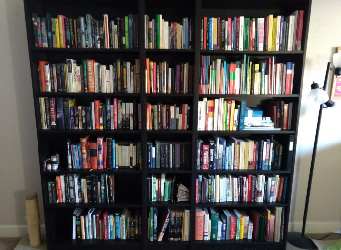 three large bookcases full of books