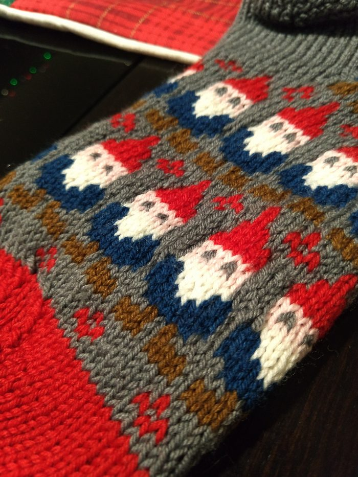 close up of the gnome pattern knitted into the socks