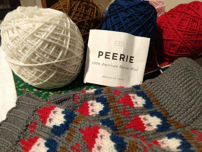 "a close up of the label for the yarns used for the gnome socks, reading ""Peerie/100% American Wool/Brooklyn Tweed"""