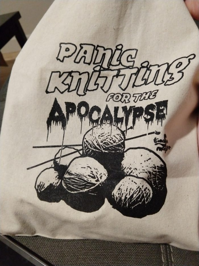 "a canvas bag for holding knitting projects with a design on it that says ""panic knitting for the apocalypse"""