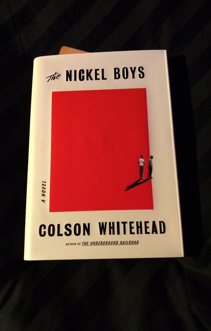 hardback book: The Nickel Boys. Pictured atop a black comforter
