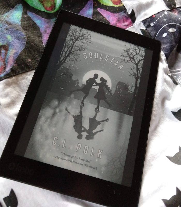 book cover for Soulstar, shown in black and white on Kobo eReader. Cover shows the silhouette of two people ice skating together