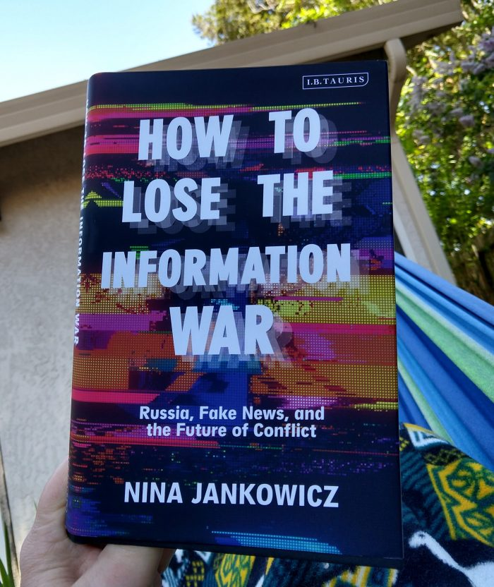 hardback book: How to Lose the Information War by Nina Jankowicz. Photo taken outside in my hammock