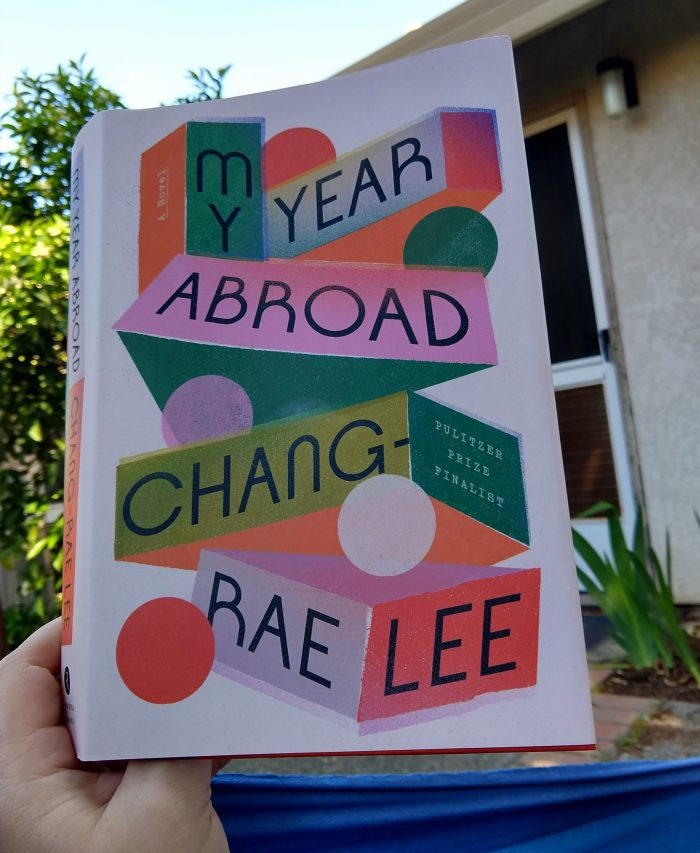hardback book: My Year Abroad by Chang-Rae Lee. Photo taken from outside in my hammock