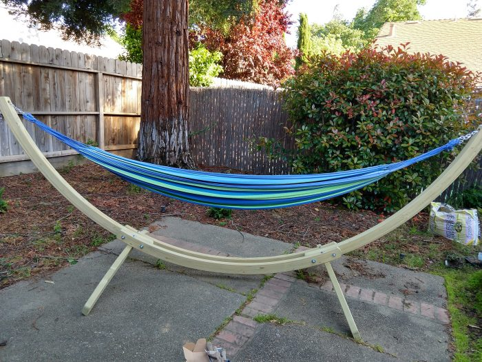 a large, wooden hammock stand set up on my back patio