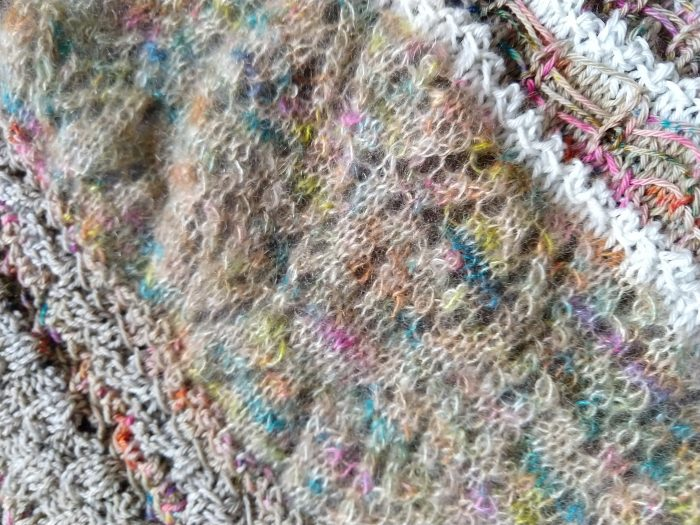 a close up of the knitted wrap of a lace section